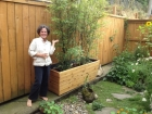 Jen in her garden with bamboo