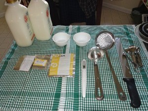 Milk and equipment - thermometer, ladles, etc. all sterilized